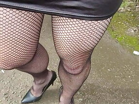 Squirt through fishnets in public. Walk and wank outdoors.